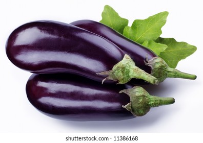 Eggplant or aubergine with egpplant slices and leaves isolated on a white background.