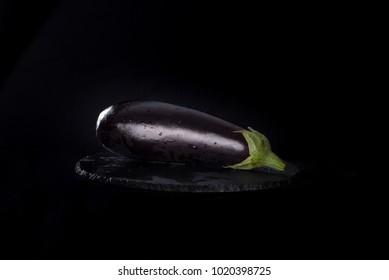 Eggplant or Aubergine fresh and tasty against black background