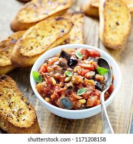 Eggplant caponata crostini or bruschetta on garlic bread