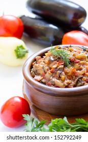 Eggplant caviar in the rustic bowl closeup. Ukrainian cuisine.
