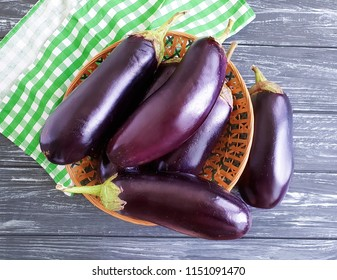 eggplant, organic on a wooden background