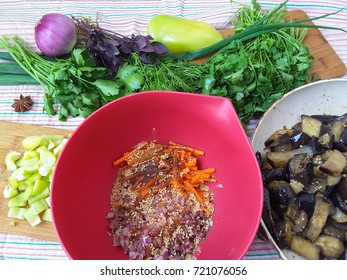 Eggplant with paprika, greenery, spices and carrots salad cooking