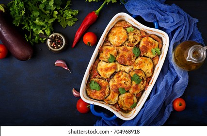 Eggplant Parmigiano (eggplant casserole) - a traditional Italian dish. Flat lay. Top view