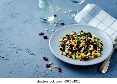 Eggplant pine nuts parsley dried cranberries salad. toning. selective focus
