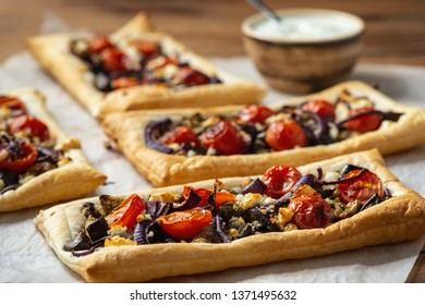 Eggplant puff pastry tarts with pomegranate and yoghurt.