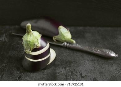 Eggplant sliced. on a black background.