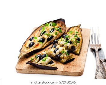 Eggplant  stuffed with black olives and feta isolated on white