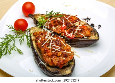 Eggplant stuffed minced meat with tomato, cheese and herbs