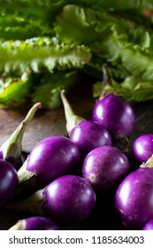 Eggplant violet preparation for cooking with old kitchen style wooden background materiel.