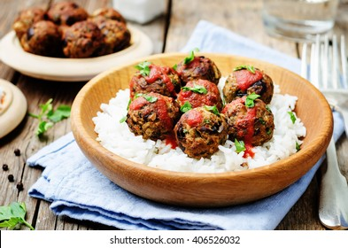 Eggplant white beans vegan meatballs with tomato sauce and rice. toning. selective focus