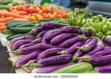 Eggplants and other vegetables on a market.
