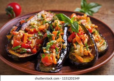 Eggplants with tomatoes, paprika, carrot, onion and garlic. Aubergine with vegetables. overhead, horizontal