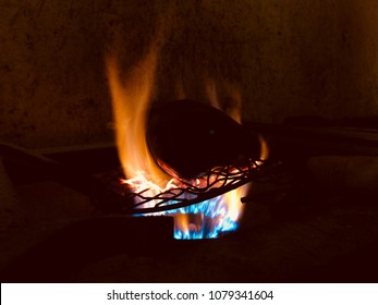 Eggplants vegetable item is burning on a kitchen stove