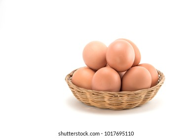 Eggs in basket isolated on white background.