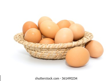 Eggs in basket isolated on white background