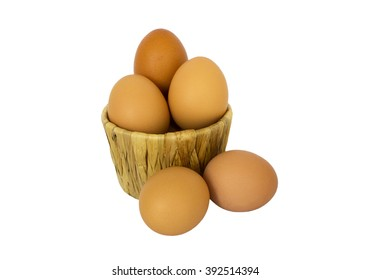 Eggs in a basket isolated on white background.