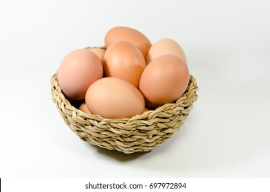 Eggs in a basket on a white background.