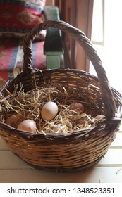 Eggs in basket on wooden background