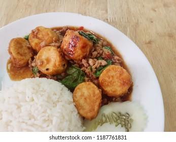 "Eggs bean curd fried stir with basil and pork in Thai style. Or in Thai is called as ""Pad Ka Paw Tao Hu Kai"". Jasmine rice"
