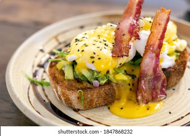 eggs benedict with bacon and Sourdough bread