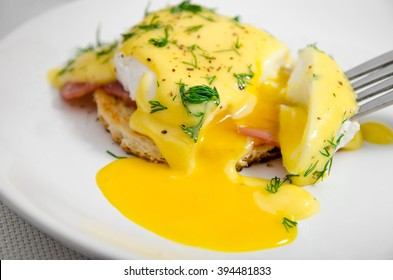 Eggs Benedict for breakfast on a white plate