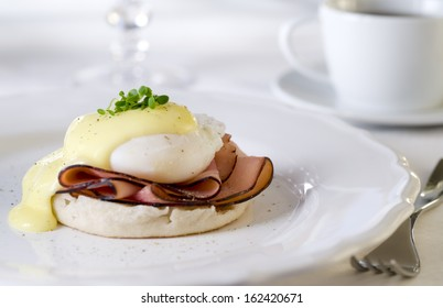 Eggs Benedict with ham and hollandaise sauce.