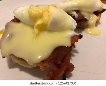 Eggs Benedict - poached eggs with hollandaise, ham and English muffin