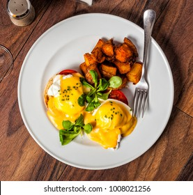 Eggs Benedict is a traditional American breakfast or brunch dish  with bacon, ham, a poached egg, and hollandaise sauce.