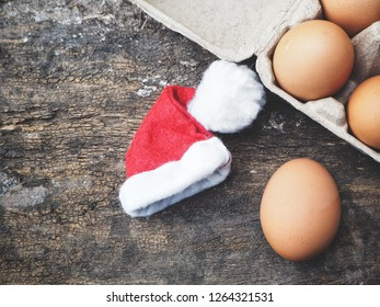 Eggs in a box with christmas hat