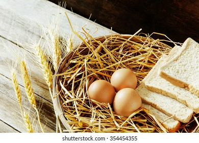 Eggs and bread in the basket with still life