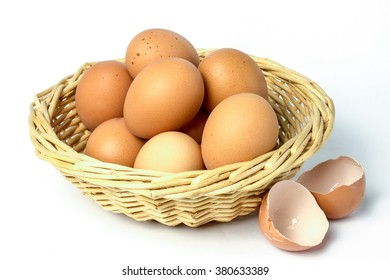 Eggs with broken shells isolated on white background.