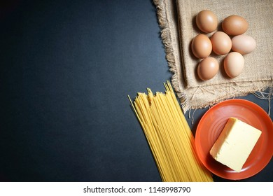 eggs, butter and pasta on sackcloth