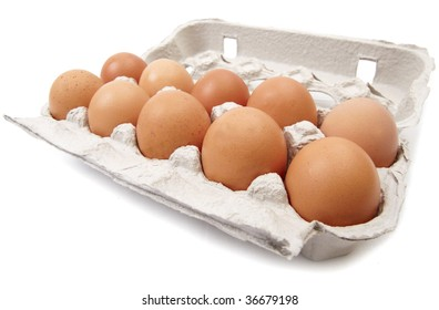 Eggs in carton, isolated on white background