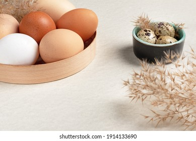 eggs of different sizes in packages. Farmed chicken and quail eggs. Healthy eating concept
