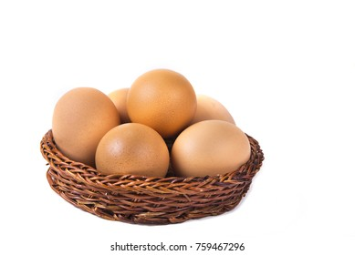 Eggs with euro coins money in basket on white.