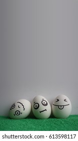 Eggs with faces photo for your design. With a place under the text. Funny and cute. Three eggs shocked in the middle