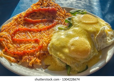 Eggs Florentine and Hashbrowns on a Dinner Plate
