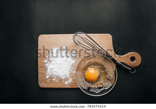 eggs and flour on dark background