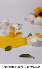 Eggs and flower on the white background