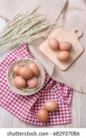Eggs with Food decorated. Design egg in wooden board and bowl, Napkin and rice wheat stalk for Decoration.