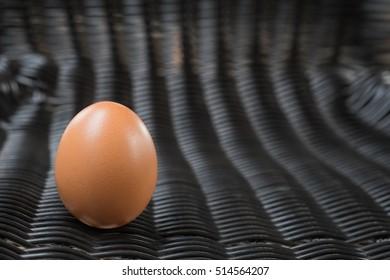 Eggs. Fresh farm eggs on a wooden rustic background.