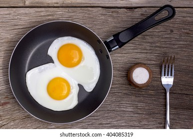 Eggs. Fried egg in a frying pan. Top view, closeup.