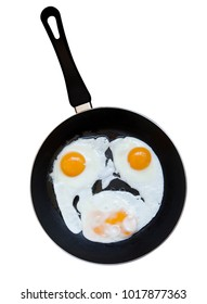Eggs fried on a pan as a smile. Isolated on a white background with path.