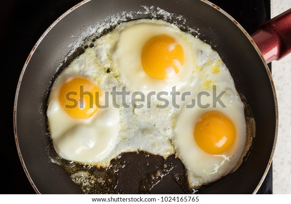 Eggs fried on a plate. Light background. Hot appetizing dish. Copy space 1
