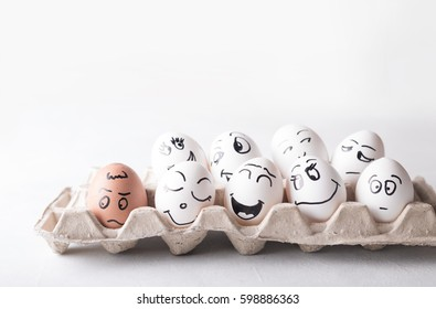 Eggs with funny faces in the package on a white background.