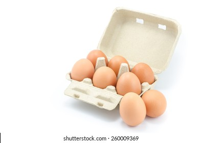 Eggs in a grey paper box on white background
