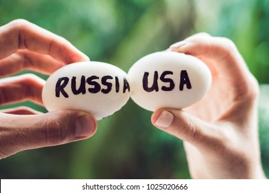 Eggs with the inscriptions of Russia and the United States, fight, who are broken. conflict between USA vs Russia, governments conflict concept.