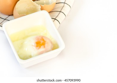 Eggs isolated on white with handkerchief. Chicken Egg. Broken egg shell. Broken egg shell on white background.
