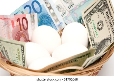 Eggs with money in basket isolated on white background. Financial concept.