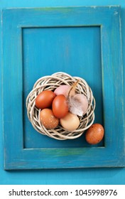 eggs in a nest on a wooden background, close-up